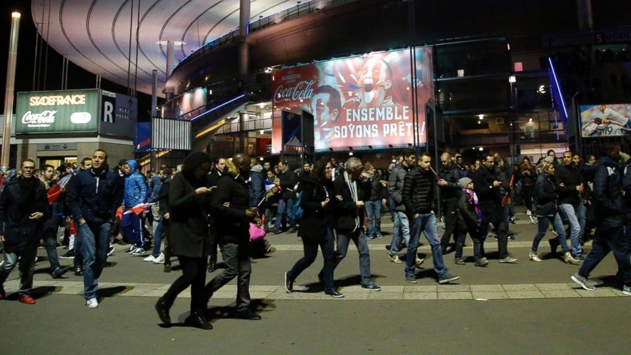 People leave the Stade de France stadium after the international friendly soccer France against Germany, Nov. 13, 2015 in Saint Denis, outside Paris.AP Photo/Michel Euler