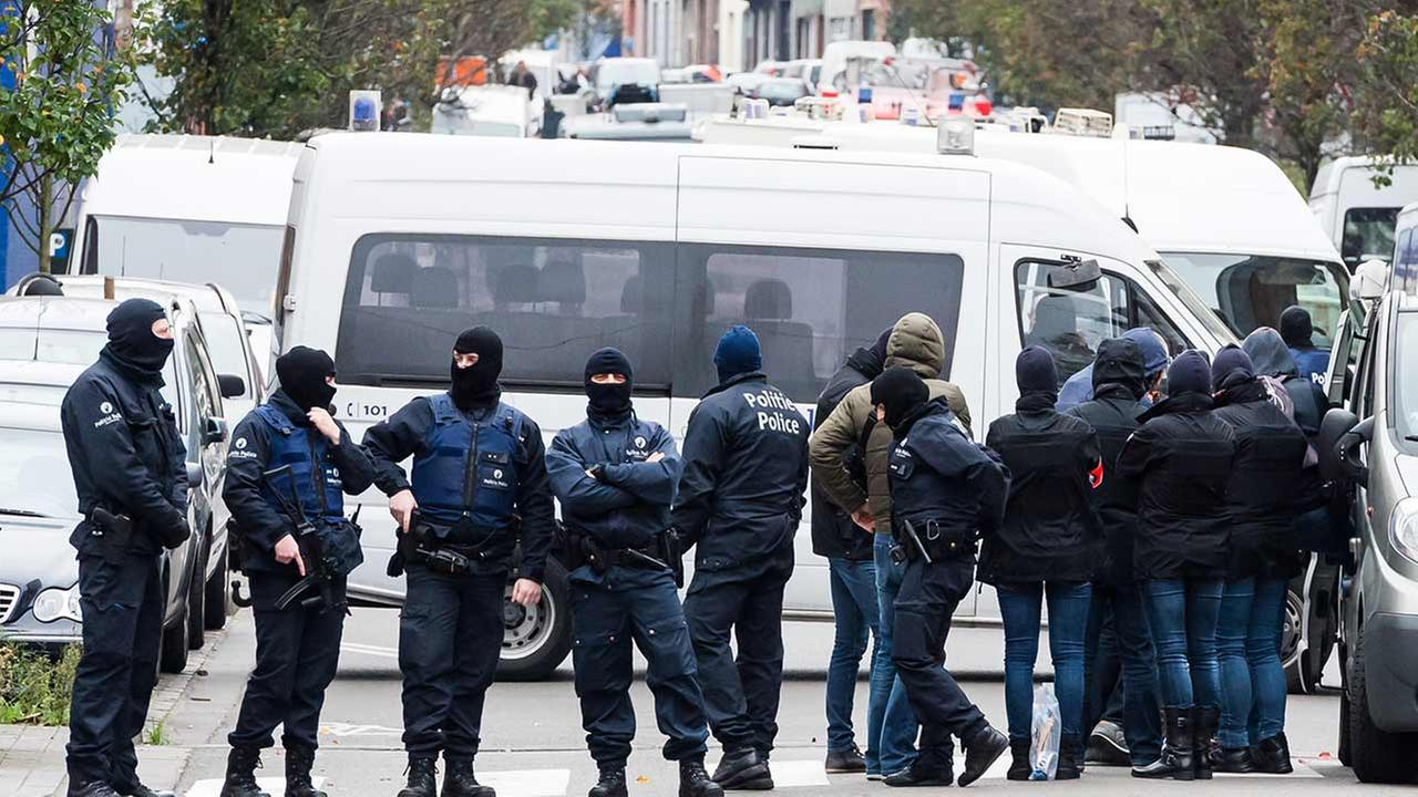 A major action with heavily armed police is underway Monday, Nov. 16, 2015 in the Brussels neighborhood of Molenbeek amid a manhunt for a suspect of the Paris attacks.
