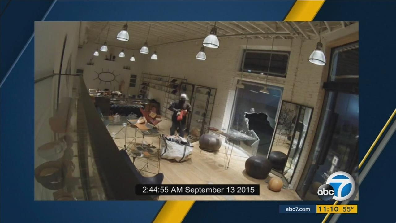 A burglar was caught on surveillance video breaking into Parabellum in the 8200 block of Melrose Avenue in the Beverly Grove area of Los Angeles on Friday, Nov. 13, 2015.