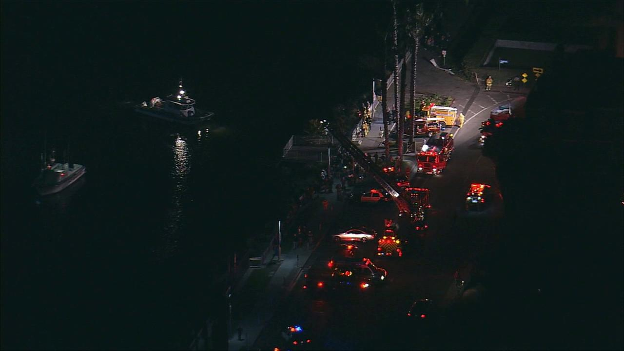 Rescue crews search Marina del Rey for vehicle after car crashes into water following hit and run on Tuesday, Nov. 17, 2015.