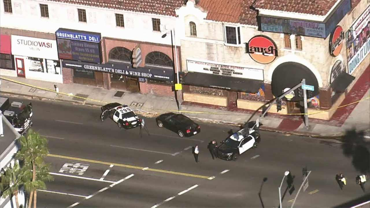 Los Angeles police investigate a suspicious package in the 8000 block of Sunset Boulevard in Hollywood on Wednesday, Nov. 18, 2015.