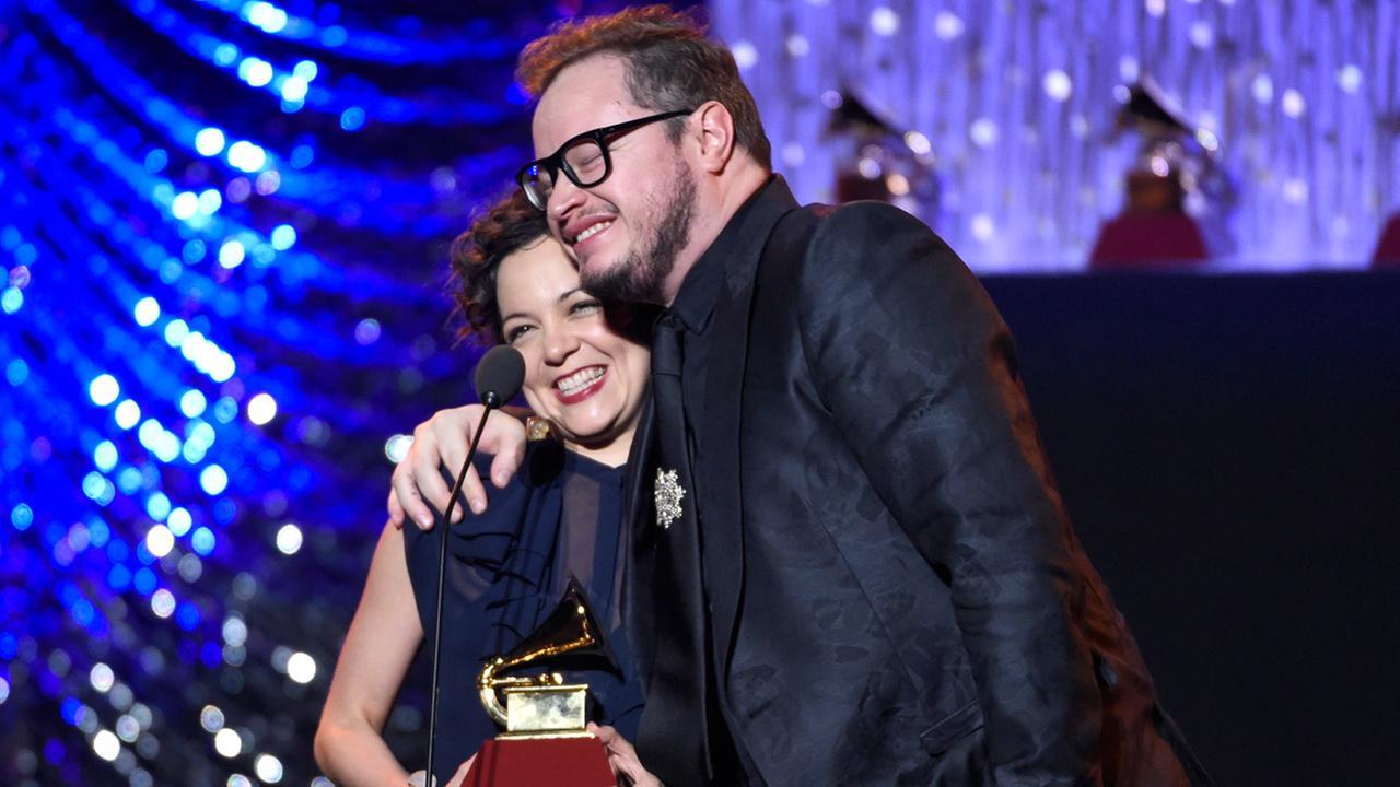 Natalia Lafourcade, left, and Leonel Garcia accept the award for best alternative song for Hasta La Raiz at the 16th annual Latin Grammy Awards on Thursday, Nov. 19, 2015.