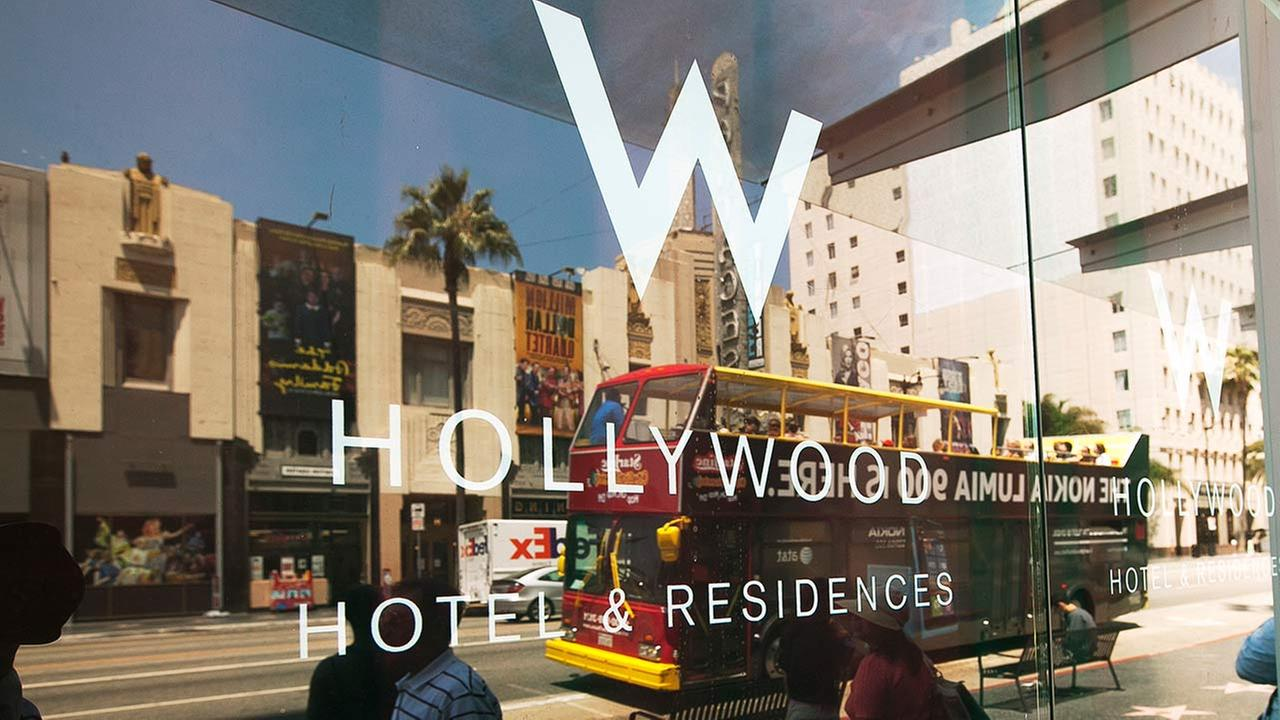 In this Tuesday, July 17, 2012 file photo, pedestrians pass by the entrance to the W Hollywood hotel and residences in Los Angeles.
