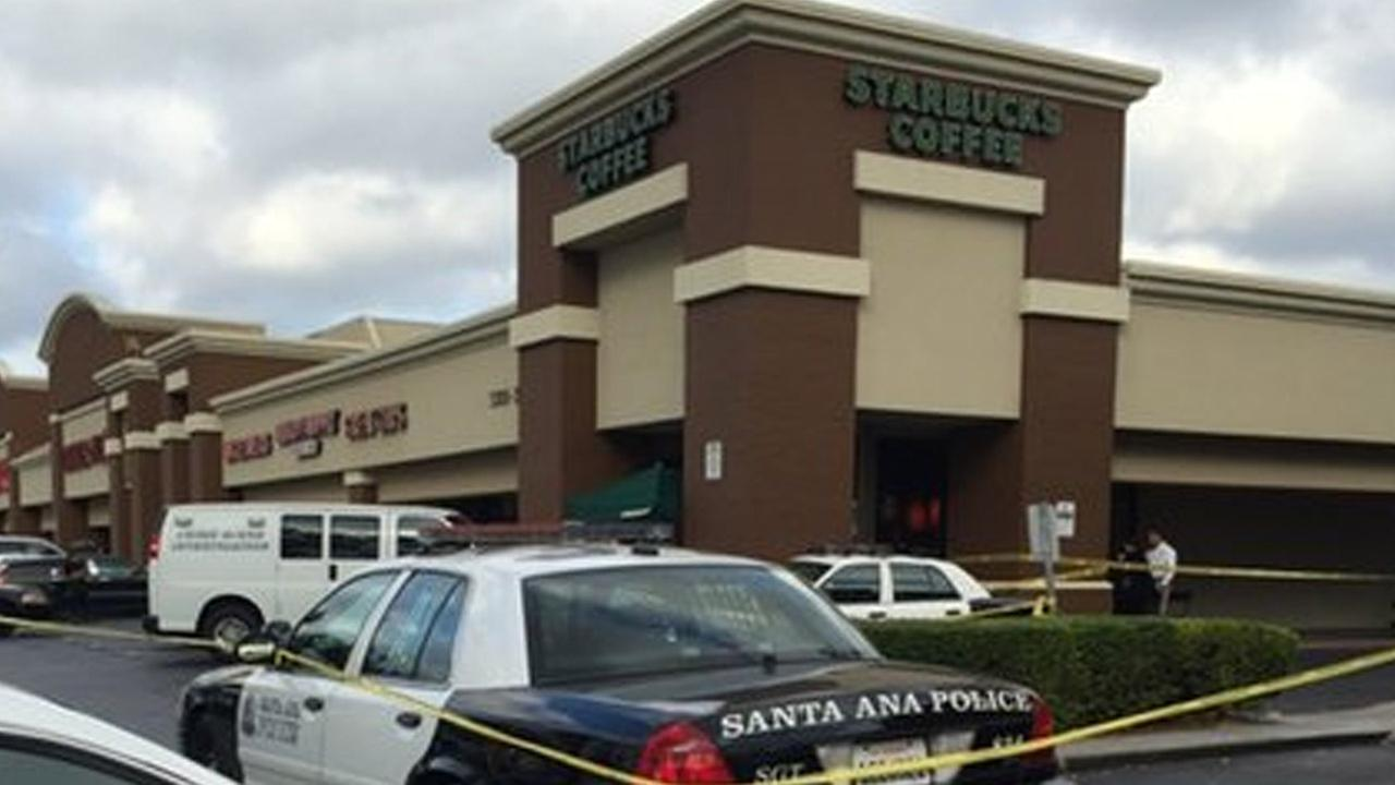 Santa Ana police cordoned off an area in front of a Starbucks where a deadly altercation broke out on Tuesday, Nov. 24, 2015.