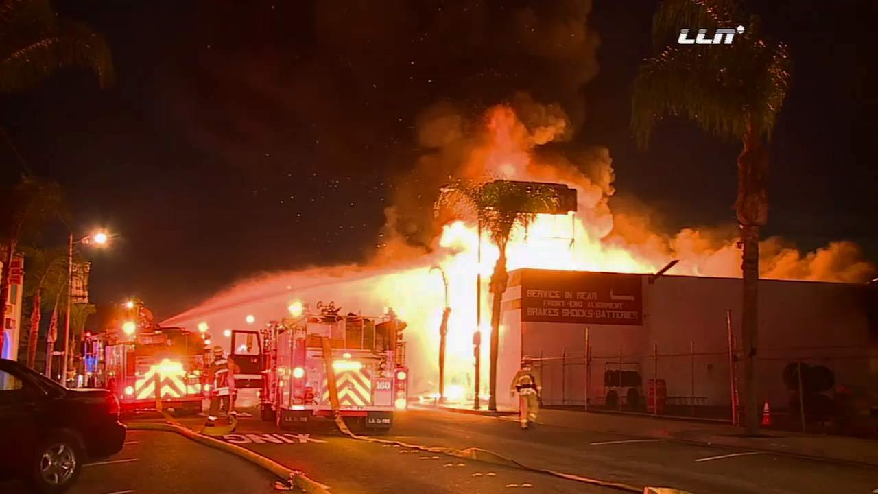 A massive fire erupted at a tire business in Gardena on Wednesday, Nov. 25, 2015.