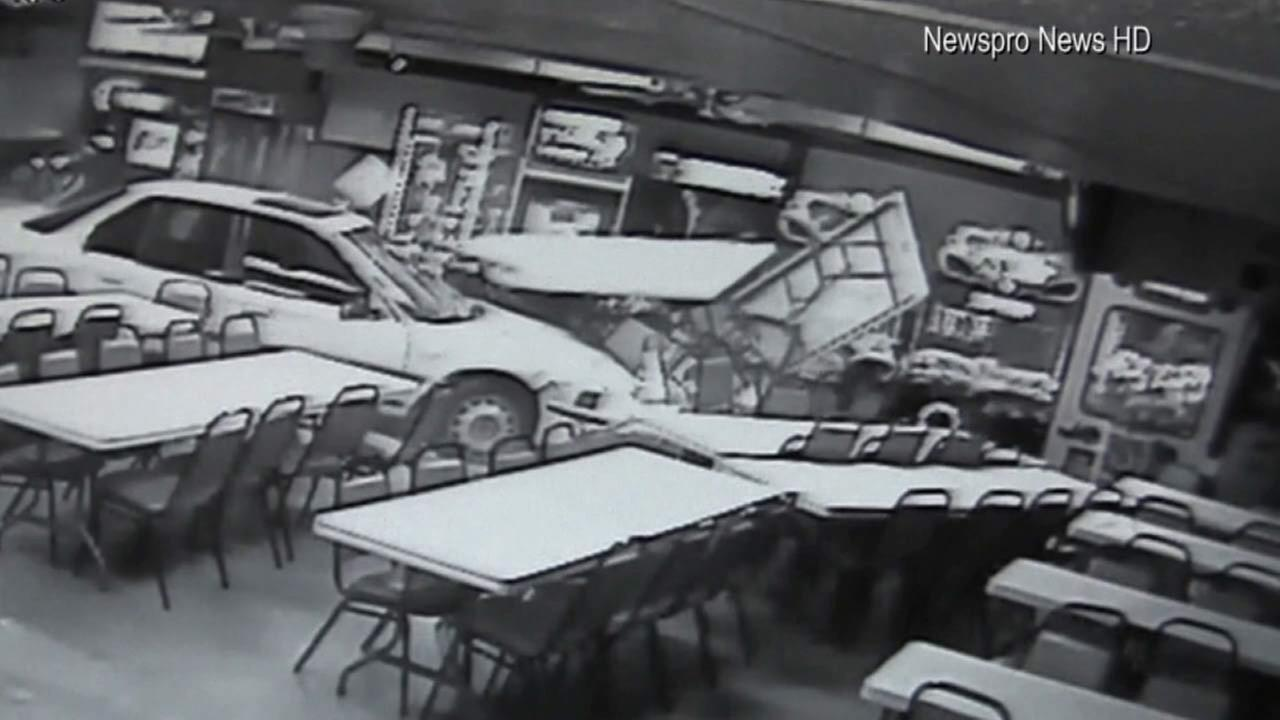 A car slammed into a San Bernardino pizza restaurant while a man and his family were having dinner on Tuesday, Nov. 25, 2015.