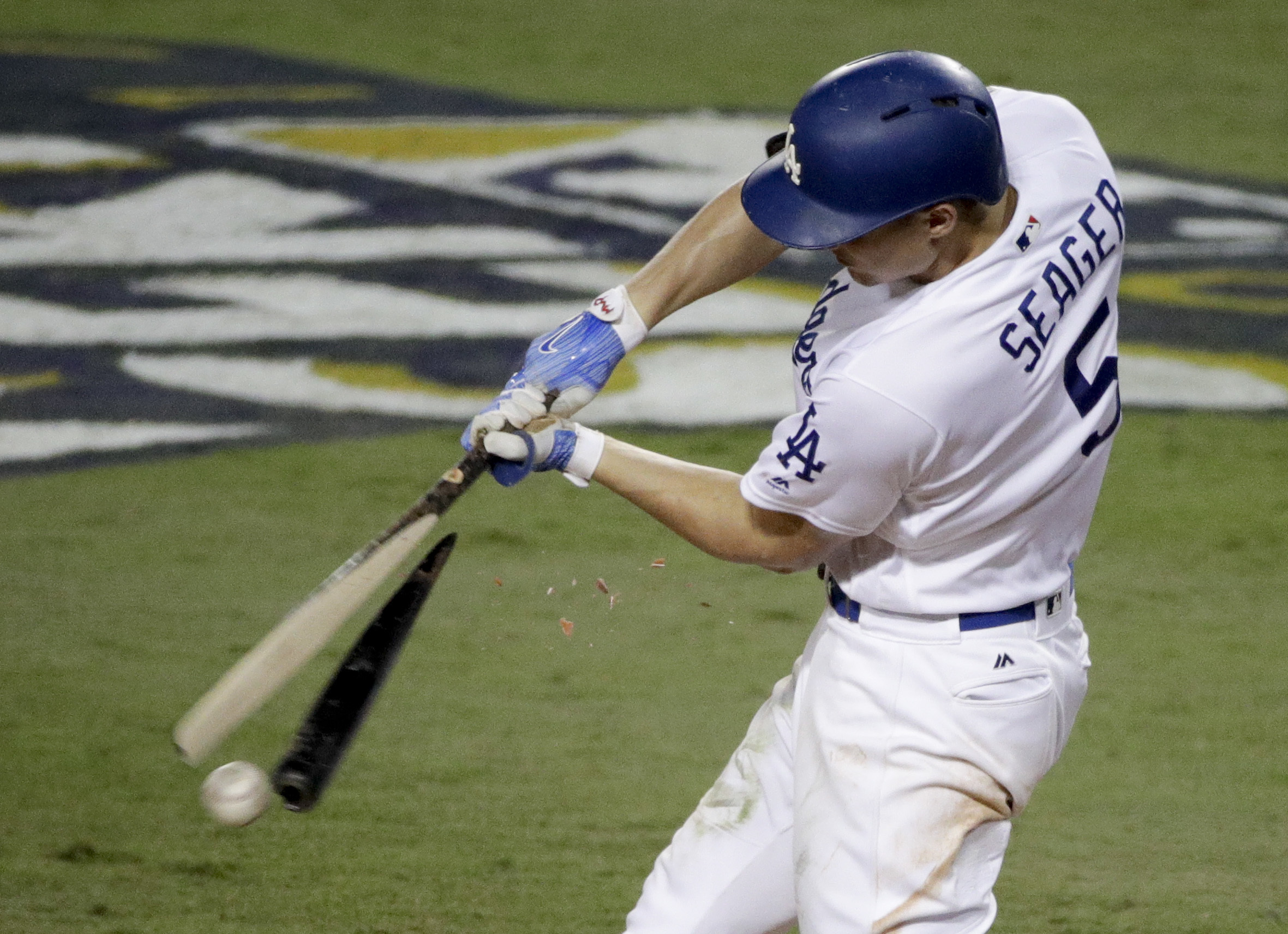 <div class='meta'><div class='origin-logo' data-origin='AP'></div><span class='caption-text' data-credit='(AP Photo/Jae C. Hong)'>Los Angeles Dodgers' Corey Seager break his bat and grounds out against the Houston Astros during the sixth inning of Game 7 of baseball's World Series Wednesday, Nov. 1, 2017.</span></div>