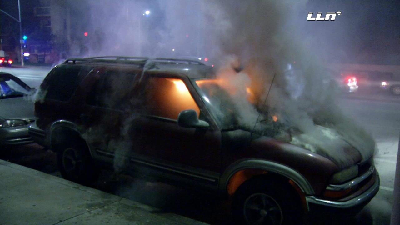 A search is underway for an arsonist who set several cars on fire in Panorama City on Friday, Nov. 27, 2015.