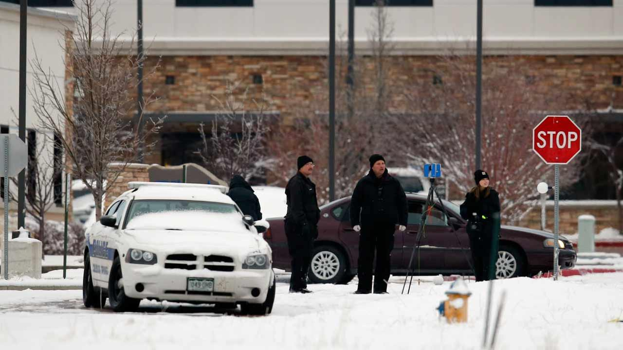 Police investigators work near a Planned Parenthood clinic Saturday, Nov. 28, 2015, in Colorado Springs, Colo., after a deadly shooting Friday.