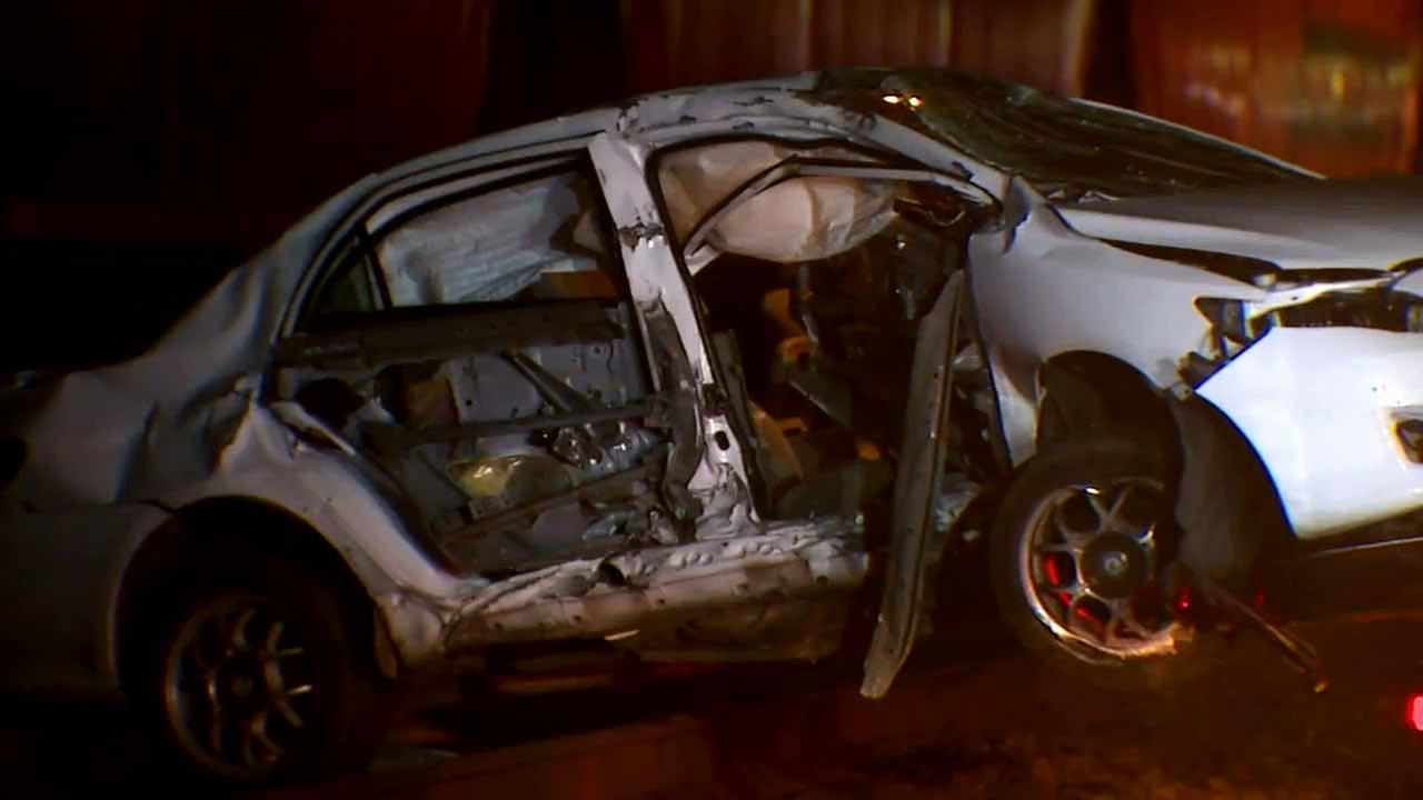 A car struck by a freight train in Auburn, Washington after four bystanders rescued an elderly driver who was inside.