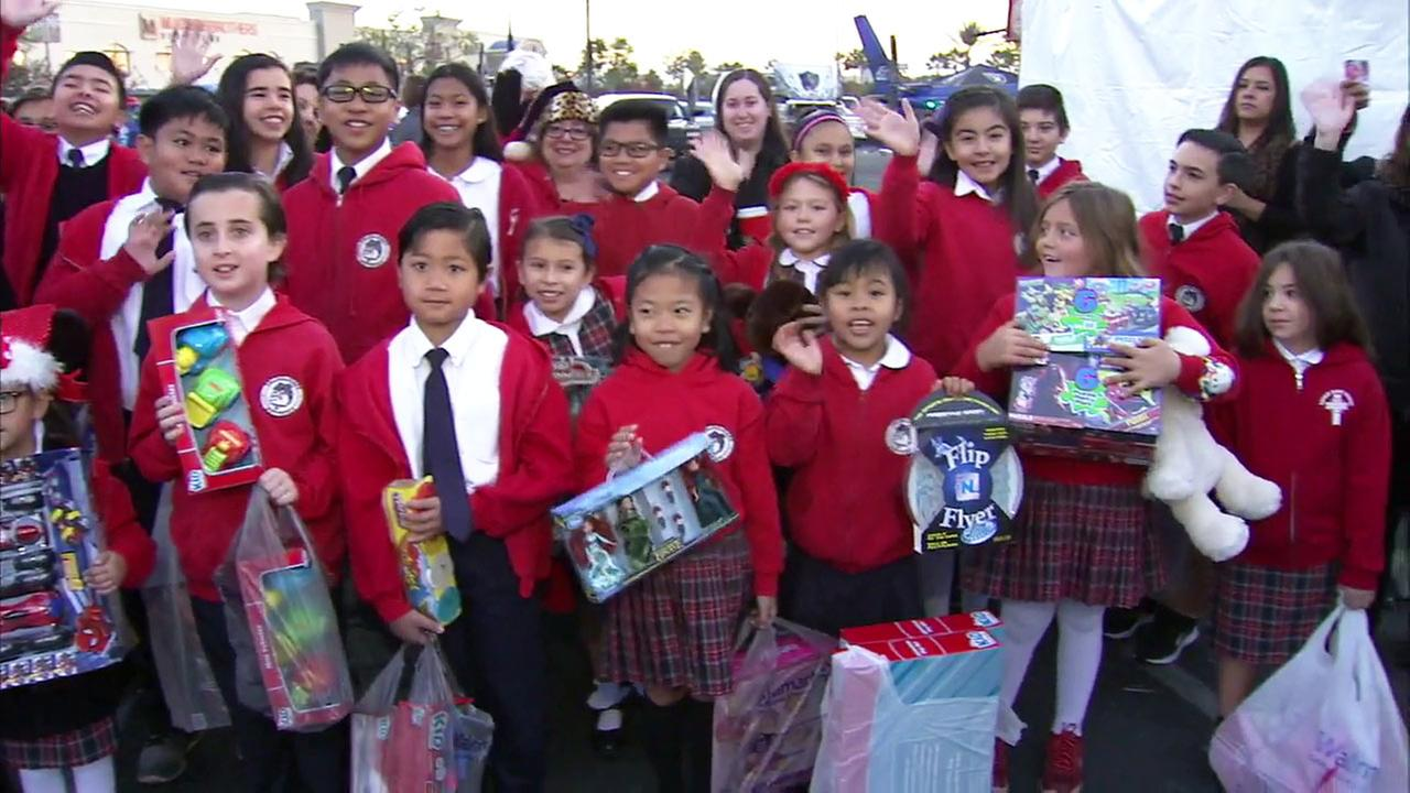 School children brought donations to our Stuff-A-Bus toy drive at Mathis Brothers in Ontario on Friday, Dec. 4, 2015.