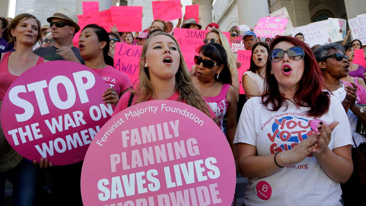 Planned Parenthood supporters rally for womens access to reproductive health care on National Pink Out Day at Los Angeles City Hall, Tuesday, Sept. 29, 2015.