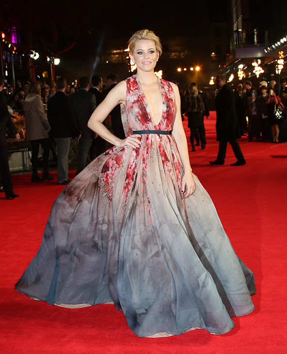 "<div class=""meta image-caption""><div class=""origin-logo origin-image ""><span></span></div><span class=""caption-text"">Elizabeth Banks poses for photographers upon arrival to the world premiere of 'The Hunger Games: Mockingjay Part 1' in London, Monday, Nov. 10, 2014. (Joel Ryan/Invision/AP)</span></div>"