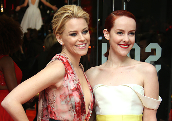 "<div class=""meta image-caption""><div class=""origin-logo origin-image ""><span></span></div><span class=""caption-text"">Elizabeth Banks and Jena Malone pose for photographers upon arrival to the world premiere of 'The Hunger Games: Mockingjay Part 1' in London, Monday, Nov. 10, 2014. (Joel Ryan/Invision/AP)</span></div>"