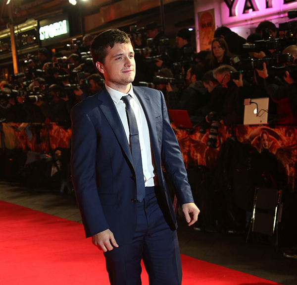 "<div class=""meta image-caption""><div class=""origin-logo origin-image ""><span></span></div><span class=""caption-text"">Josh Hutcherson poses for photographers upon arrival to the world premiere of 'The Hunger Games: Mockingjay Part 1' in London, Monday, Nov. 10, 2014. (Joel Ryan/Invision/AP)</span></div>"