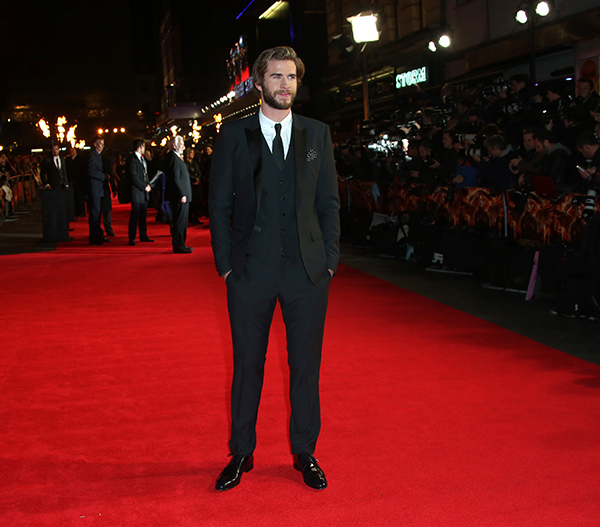 "<div class=""meta image-caption""><div class=""origin-logo origin-image ""><span></span></div><span class=""caption-text"">Liam Hemsworth poses for photographers upon arrival to the world premiere of 'The Hunger Games: Mockingjay Part 1' in London, Monday, Nov. 10, 2014. (Joel Ryan/Invision/AP)</span></div>"