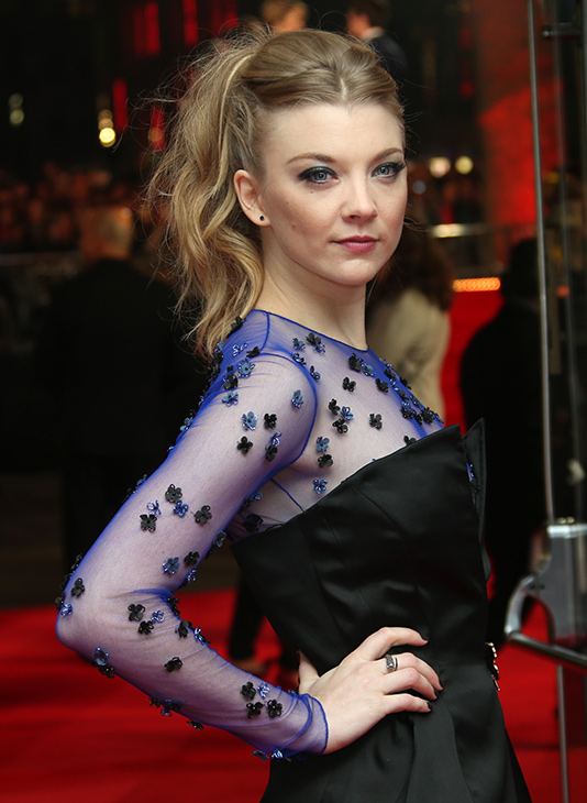 "<div class=""meta image-caption""><div class=""origin-logo origin-image ""><span></span></div><span class=""caption-text"">Natalie Dormer poses for photographers upon arrival to the world premiere of 'The Hunger Games: Mockingjay Part 1' in London, Monday, Nov. 10, 2014.  (Joel Ryan/Invision/AP)</span></div>"