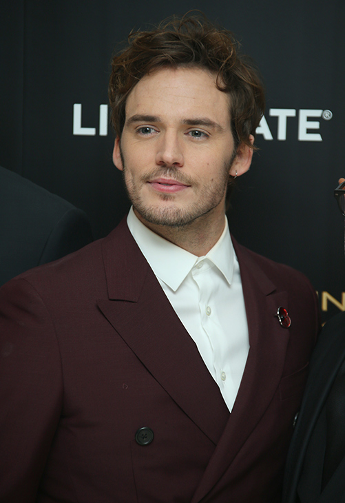 "<div class=""meta image-caption""><div class=""origin-logo origin-image ""><span></span></div><span class=""caption-text"">Sam Claflin poses for photographers upon arrival to the world premiere of 'The Hunger Games: Mockingjay Part 1' in London, Monday, Nov. 10, 2014. (Joel Ryan/Invision/AP)</span></div>"