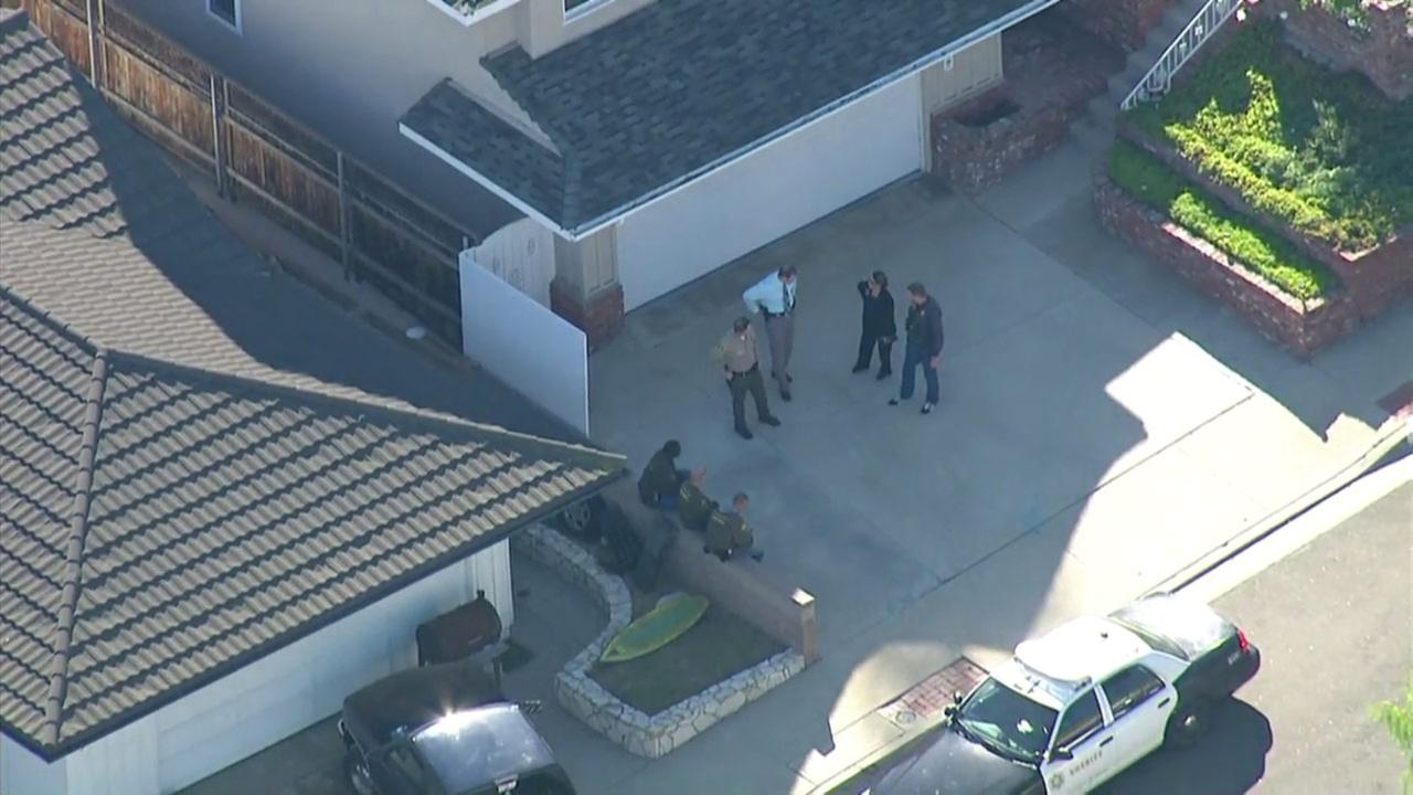 Detectives serve search warrants at a house in Rancho Palos Verdes in Monday, Dec. 7, 2015.