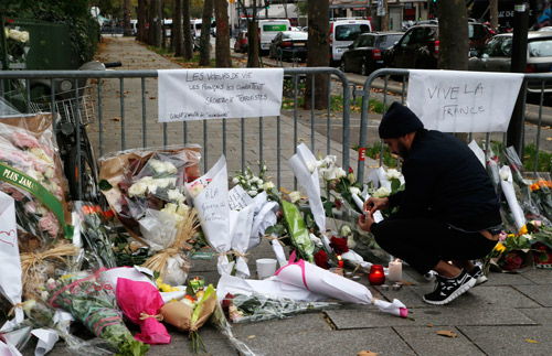 <div class='meta'><div class='origin-logo' data-origin='none'></div><span class='caption-text' data-credit='AP Photo/Michel Euler'>A man lights up a candle outside the Bataclan theater in Paris, Saturday, Nov. 14, 2015.</span></div>