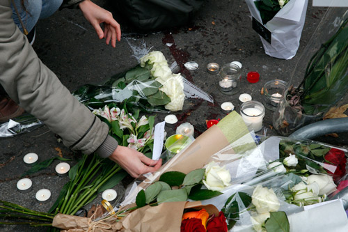 <div class='meta'><div class='origin-logo' data-origin='none'></div><span class='caption-text' data-credit='AP Photo/Christophe Ena'>A woman places a candle and reads a message outside the Bataclan concert hall, Saturday, Nov. 14, 2015 in Paris.</span></div>