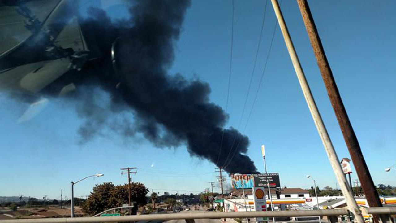 A fire breaks out in a recycling yard near Torrance on Saturday, Dec. 12, 2015.