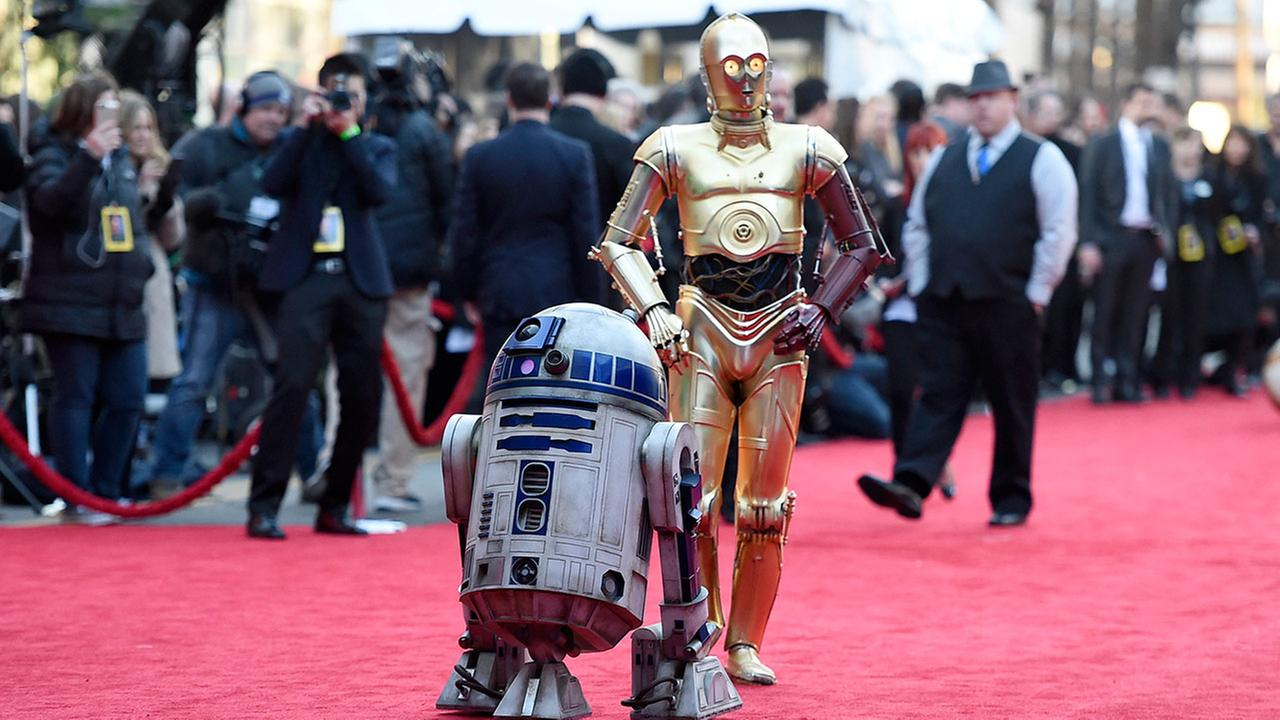 Film characters R2-D2, left, and C-3PO arrive at the world premiere of Star Wars: The Force Awakens at the TCL Chinese Theatre on Monday, Dec. 14, 2015, in Los Angeles.