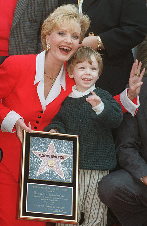 "<div class=""meta image-caption""><div class=""origin-logo origin-image ap""><span>AP</span></div><span class=""caption-text"">Florence Henderson celebrates receiving the 2,061st star on the Hollywood Walk of Fame with her grandson Kyle Russell, 2, Wednesday, Feb. 14, 1996, in Hollywood. (AP Photo/Chris Pizzello)</span></div>"