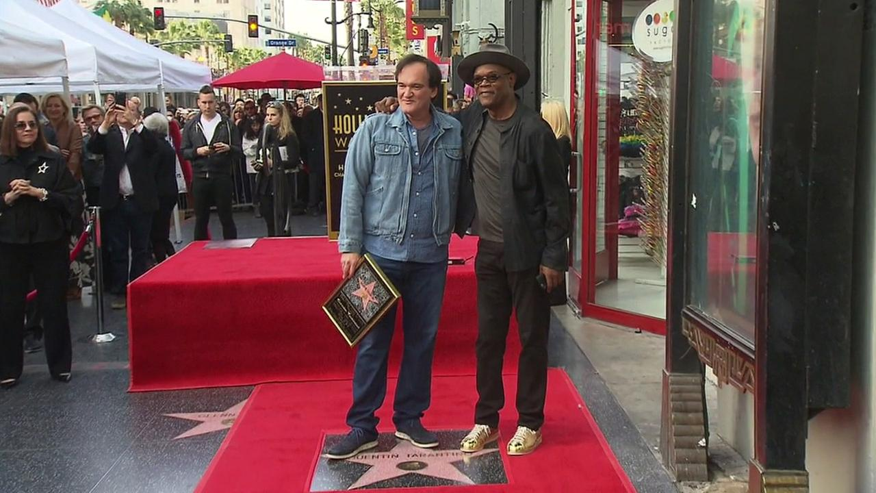 Director Quentin Tarantino stands near his new Hollywood star and poses for a photo with friend and actor Samuel L. Jackson on Monday, Dec. 21, 2015.