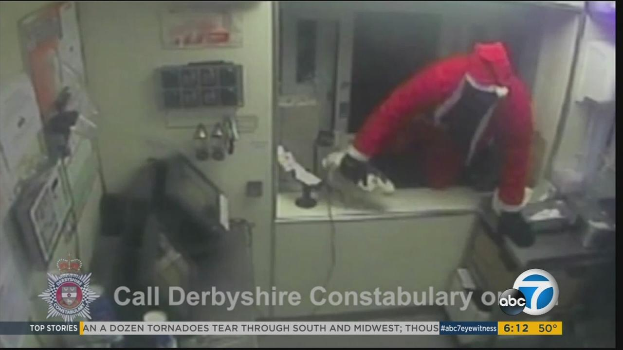 A man dressed as Santa Claus climbed through a KFC drive-thru window in Derbyshire, England and robbed the fast food restaurant at knifepoint on Saturday, Dec. 19, 2015.