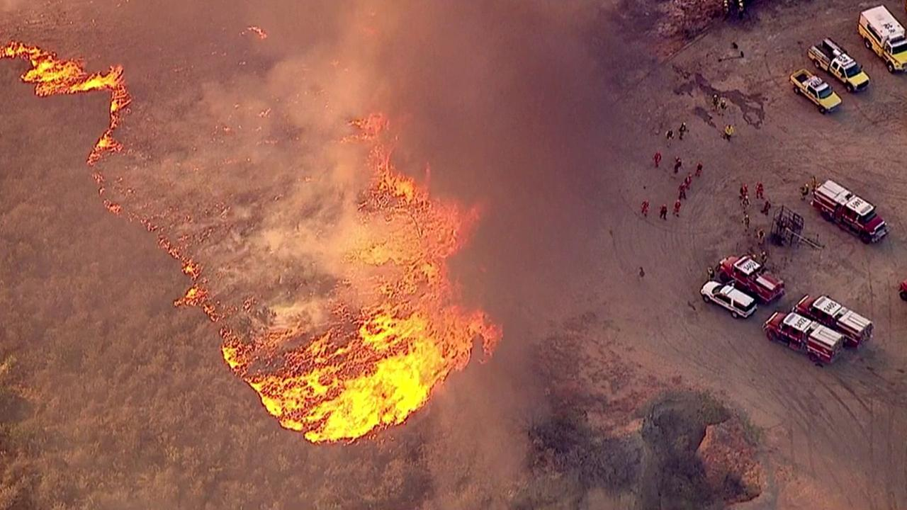 Bright flames are captured by AIR 7 HD as the Solimar Beach fire rushes through hillsides in Ventura.