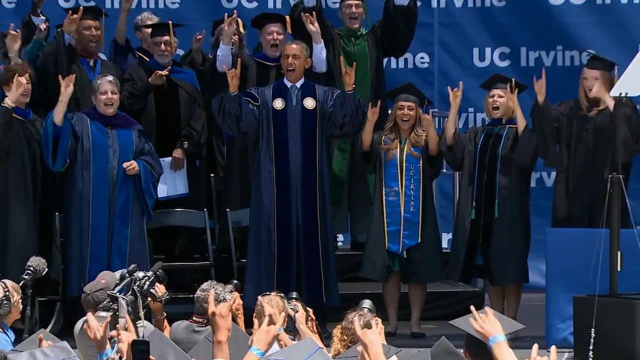 President Barack Obama performs the UC Irvine chant during their commencement ceremony on Saturday, June 14, 2014.