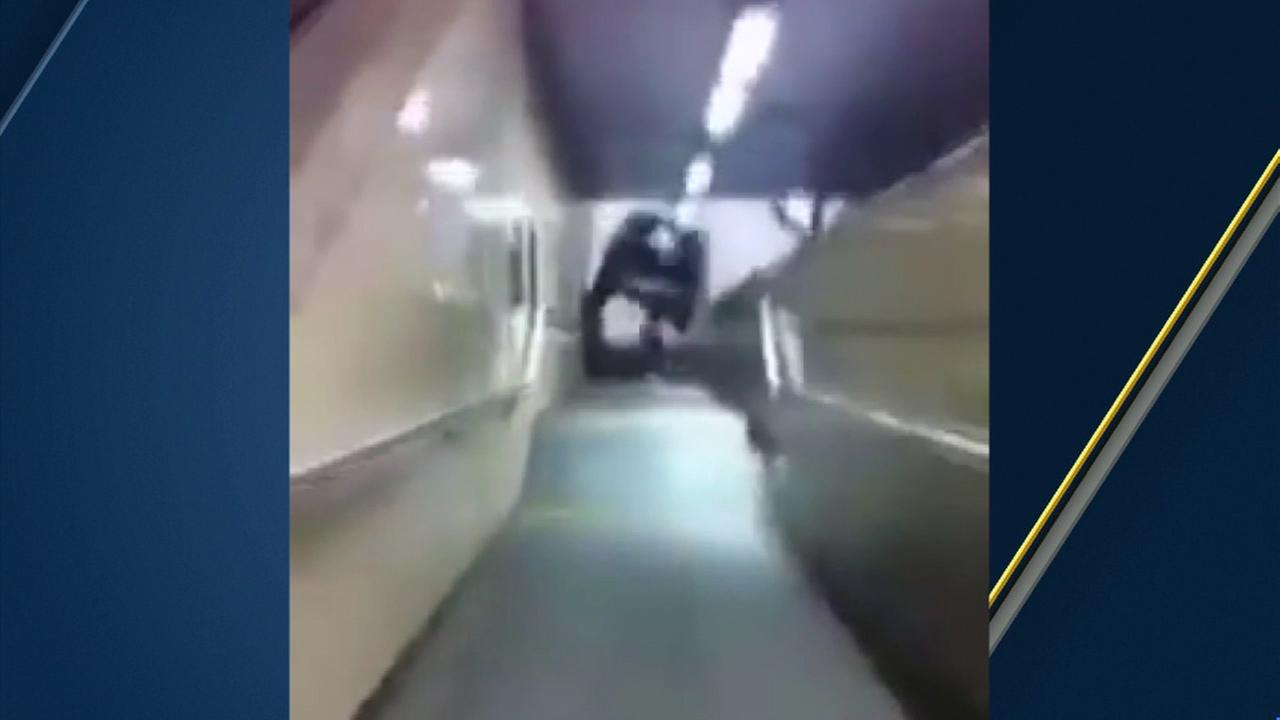 The moment teenagers pushed a car down a flight of stairs at a Brussels, Belgium train station was all captured on video New Years Eve.