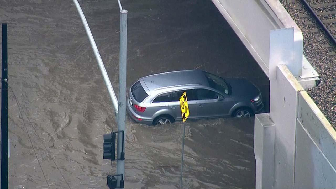 Cars were seen stuck in standing water near the intersection of Tuxford Street and San Fernando Road in Sun Valley on Wednesday, Jan. 6, 2016.KABC