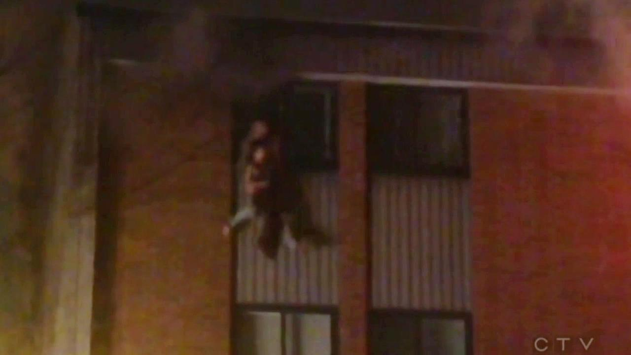 A family trapped in an apartment fire jumps from the fourth floor in Quebec City, Canada on Wednesday, Jan. 6, 2016.