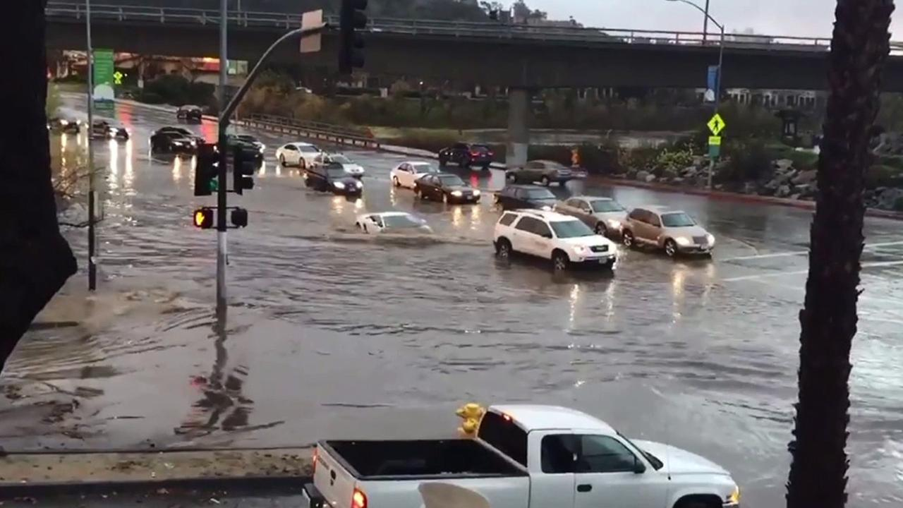 A Lamborghini was spotted plowing straight through a severely flooded intersection in San Diego on Monday, Jan. 5, 2016.