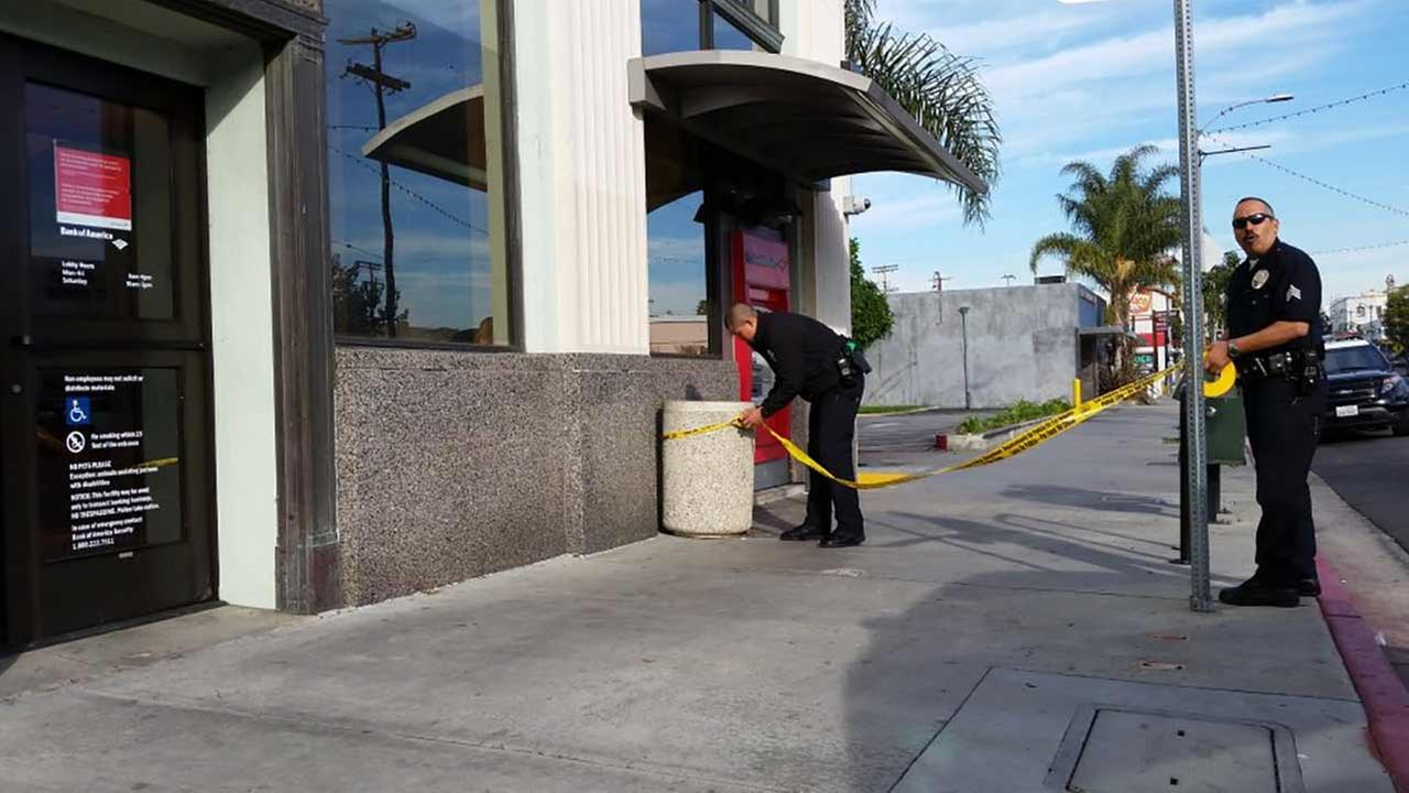 Los Angeles police respond to a report of a bank robbery near W. 9th Street and S. Pacific Avenue in San Pedro on Monday, Jan. 11, 2016.