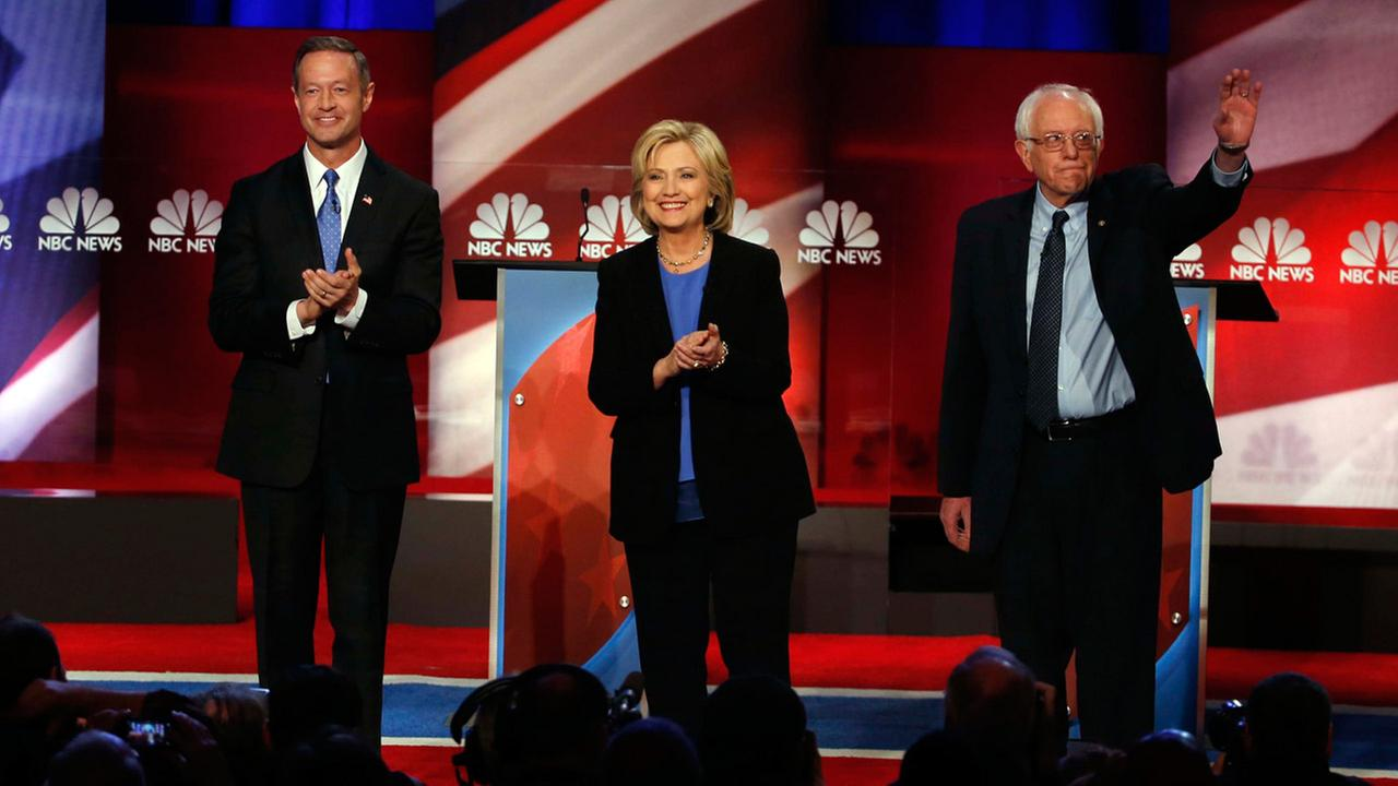 Democratic presidential candidates former Maryland Gov. Martin OMalley, left, Hillary Clinton, center, and Sen. Bernie Sanders, I-Vt, stand together before the debate.