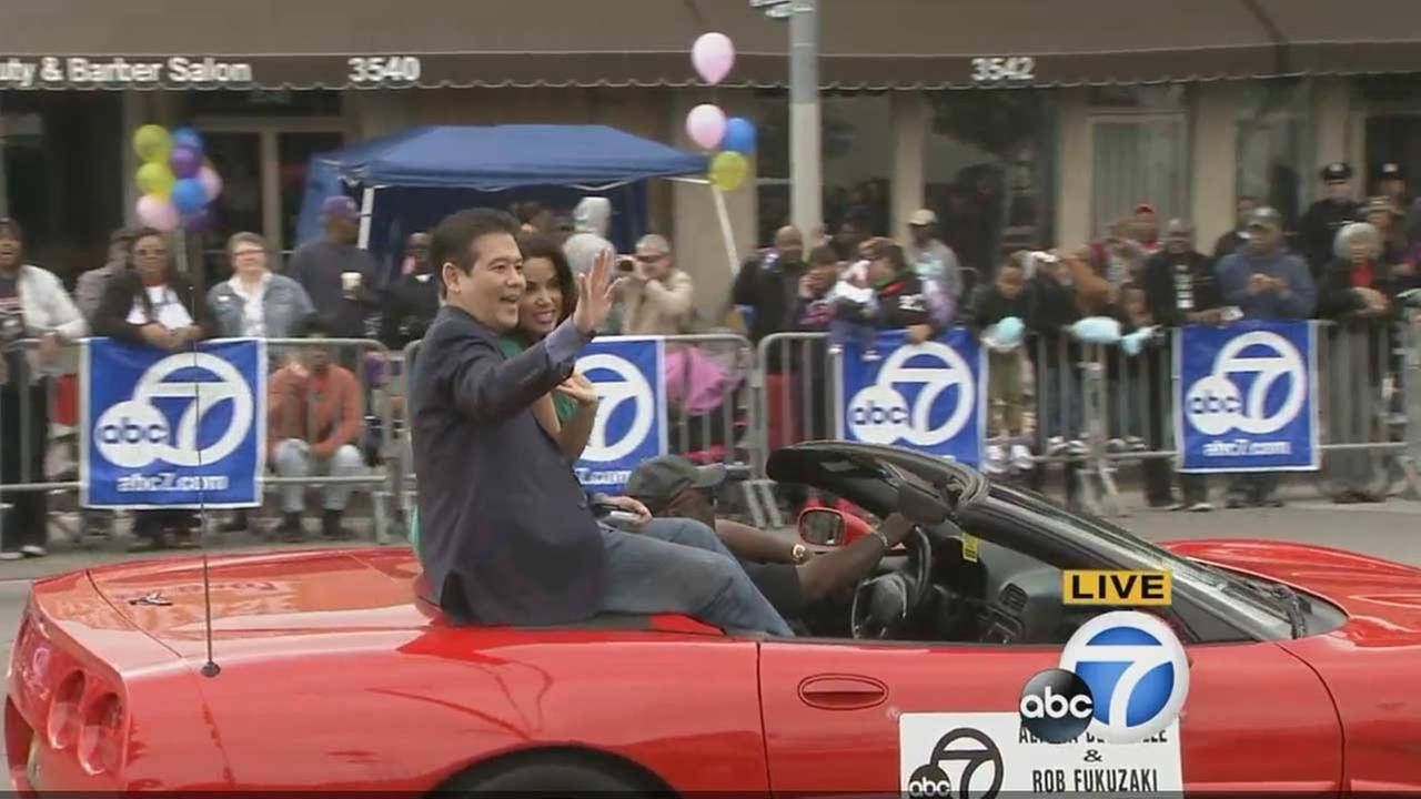 ABC7s Rob Fukuzaki and Alysha del Valle participate in the Kingdom Day Parade in South Los Angeles on Monday, Jan. 18, 2016.KABC