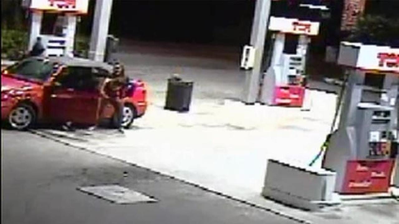 Surveillance captures a mother fighting off armed carjackers as her two children sit inside the vehicle in Hialeah, Florida on Monday, Jan. 19, 2016.