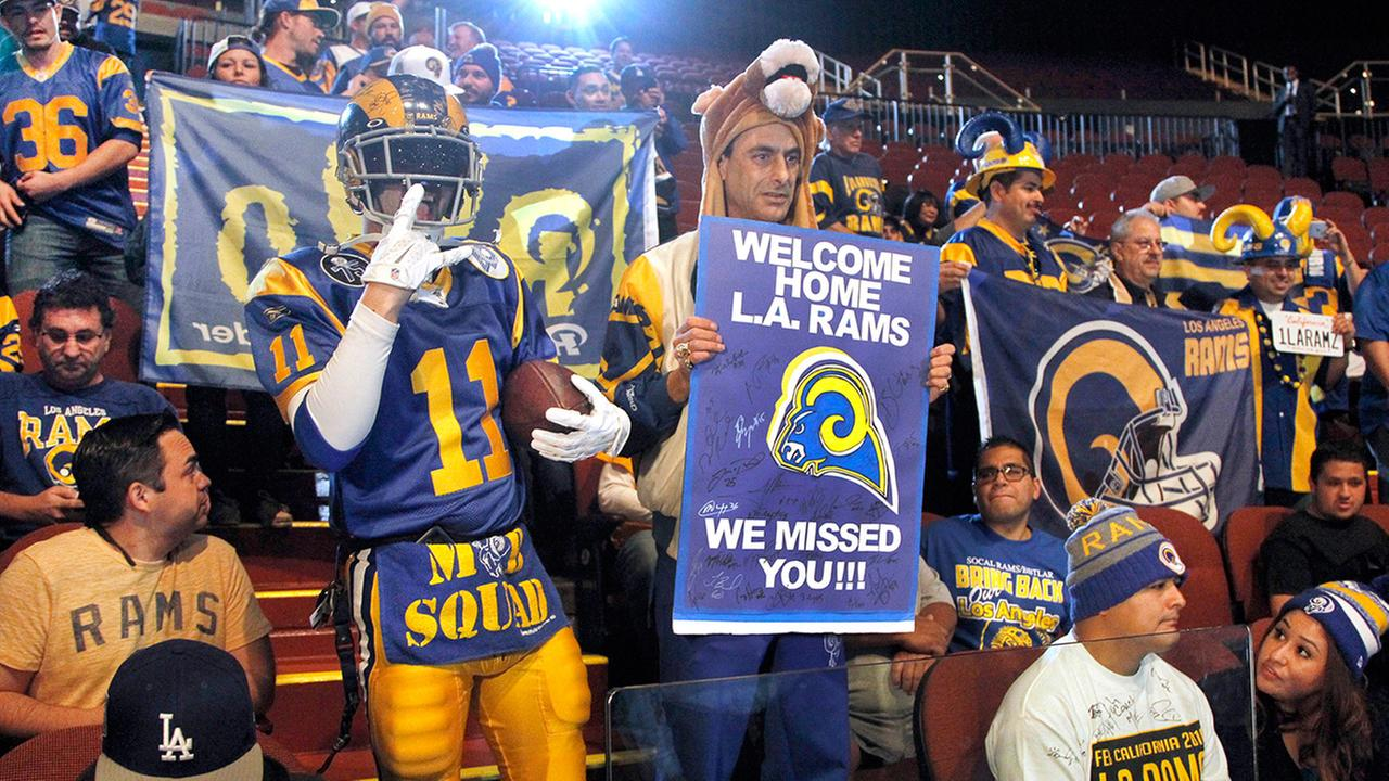 Rams fans cheer for the NFL football team at a news conference at the Forum in Inglewood, Calif., on Friday, Jan. 15, 2016.