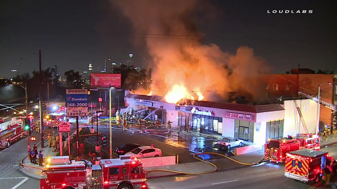 Los Angeles firefighters battle a blaze at a strip mall in the 2100 block of E. Whittier Boulevard in Boyle Heights Friday, Jan. 22, 2016.