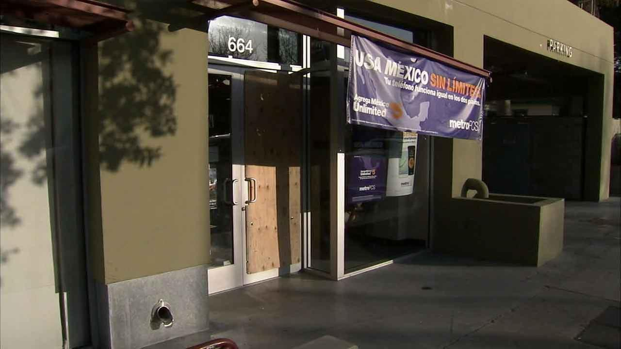 A Metro PCS store boarded up after a smash-and-grab in Pasadena, Calif. on Sunday, Jan. 24, 2016.