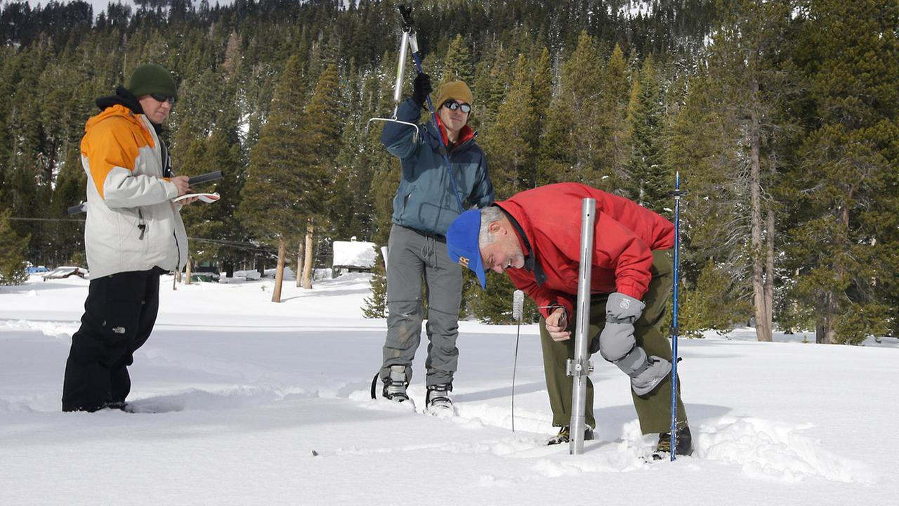 California Cooperative Snow Surveys Program for the Department of Water Resources officials check the snowpack depth in the first manual snow survey of the season on Dec. 30, 2015.