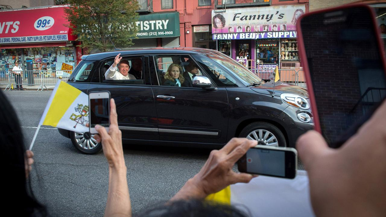 Pope Francis waves from his Fiat 500 as he is driven down Third Avenue after visiting Our Lady Queen of Angels School, Friday, Sept. 25, 2015, in New York.