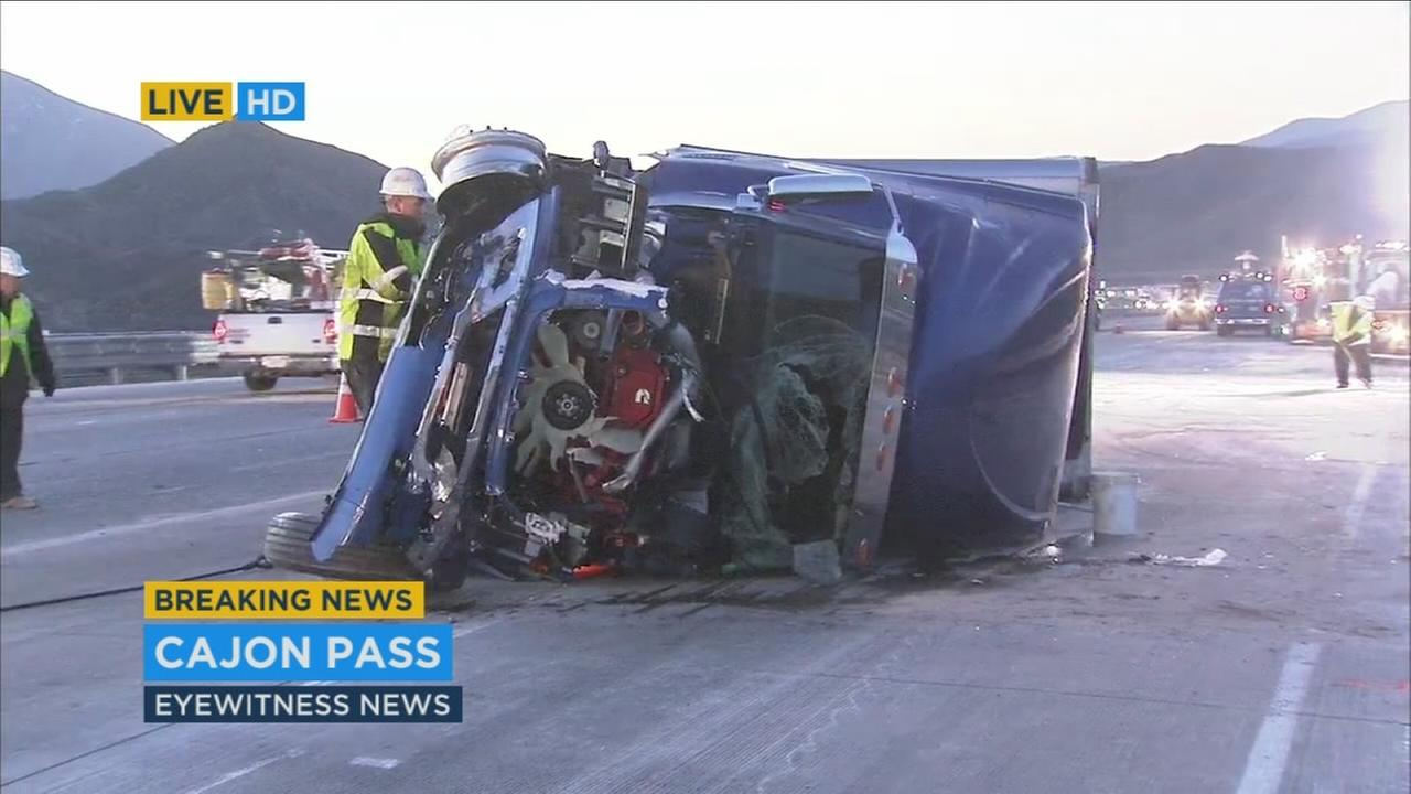 A tractor-trailer overturned on the southbound 15 Freeway near Highway 138 in the Cajon Pass Monday, Feb. 1, 2016.