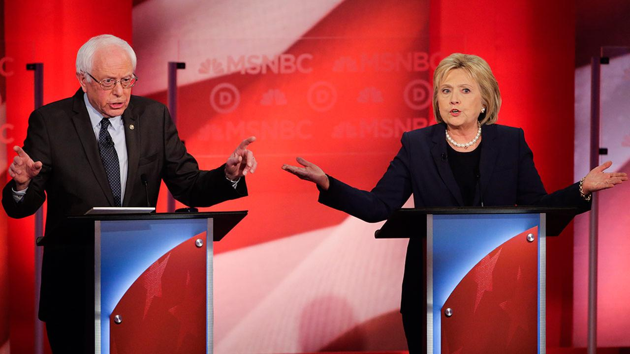 Democratic presidential candidates Sen. Bernie Sanders and former Secretary of State Hillary Clinton spar during a Democratic presidential primary debate Thursday, Feb. 4, 2016.
