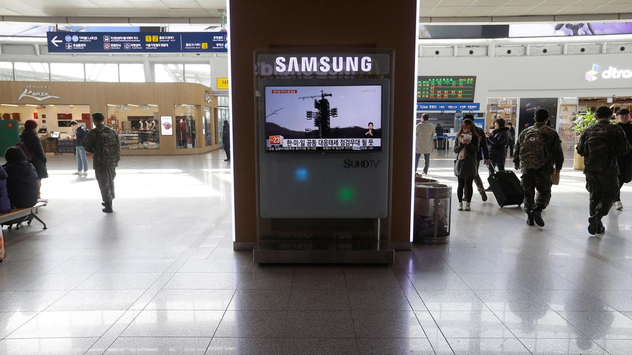 A TV screen shows file footage about North Koreas rocket launch plans at Seoul Railway Station in Seoul, South Korea, Friday, Feb. 5, 2016.