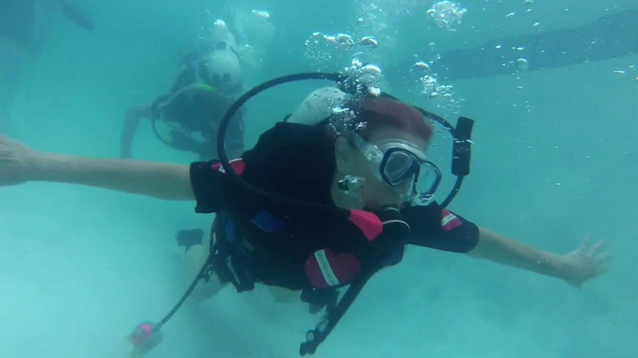 Irma Groot, of Phoenix, Arizona, practices scuba diving in a pool as part of her training at Diveheart in Rancho Palos Verdes.