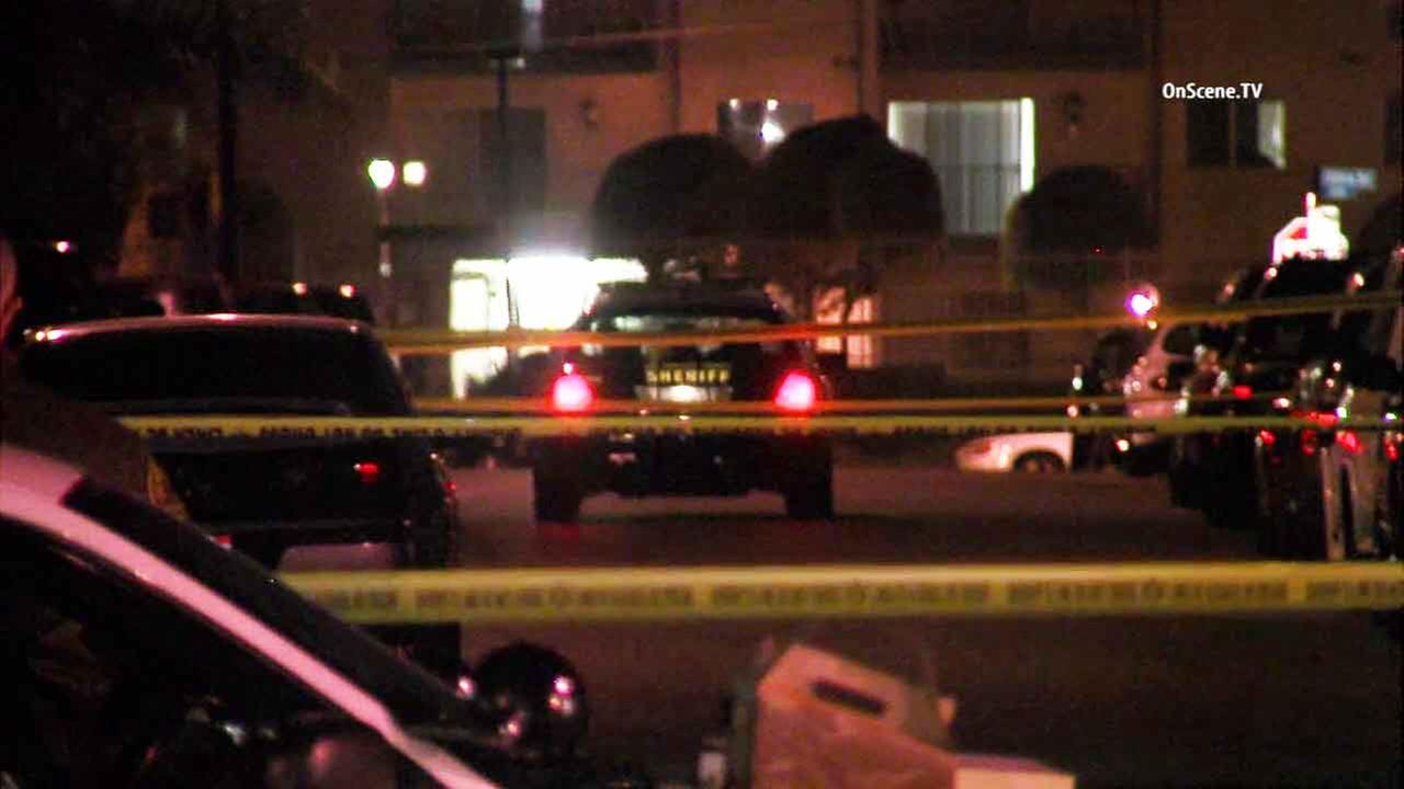 Los Angeles County sheriffs deputies on scene of a quadruple shooting in an unincorporated area of Los Angeles on Saturday, Feb. 6, 2016.